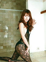 Saki Yamaguchi Asian in lace outfit shows hot curves at window