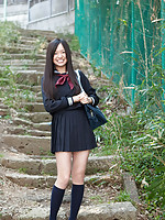 Mayumi Yamanaka Asian takes a walk in her city after classes